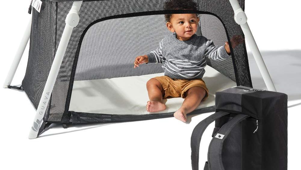 lotus travel crib toddler